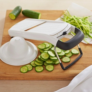 OXO Simple Mandoline $50 - Williams-Sonoma Angled stainless-steel blade easily adjusts for three precise thicknesses, plus julienne strips.