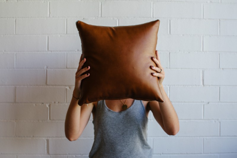 Tan leather cushion by Mr & Mrs White via WeeBirdy.com