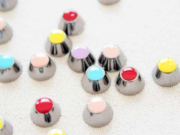 Nail varnished studs for Chanel-inspired top. Tutorial by Tuts+