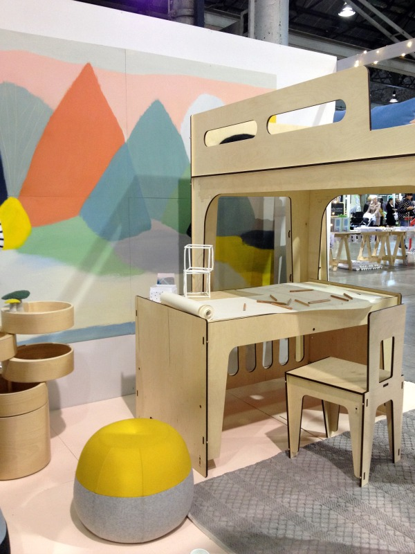 Plyroom plywood cot, multi-purpose cylindrical storage unit and bed with Belynda Henry artwork at One Fine Baby Sydney Fair via WeeBirdy.com