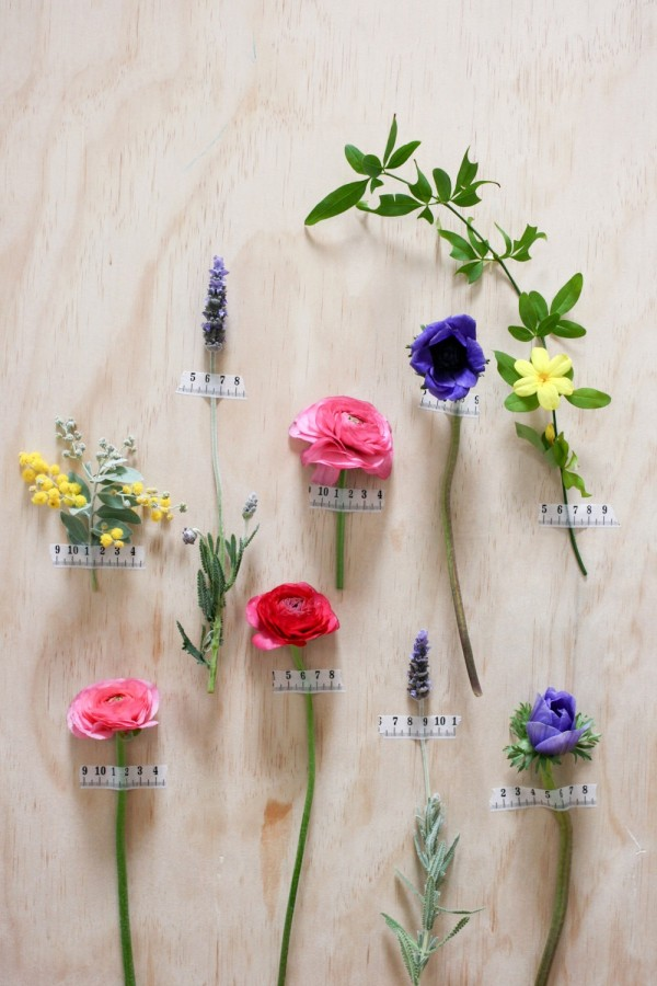 Decorate your walls for a party with single fresh flowers and tape, via WeeBirdy.com
