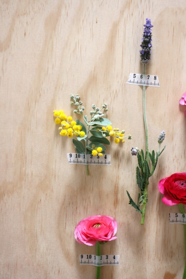 Decorate your walls with sprigs of spring flowers and Typo tape. Photography by Wee Birdy.