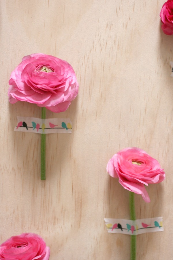 Decorate your walls for a party using single fresh blooms and Typo tape. Photography by Wee Birdy.