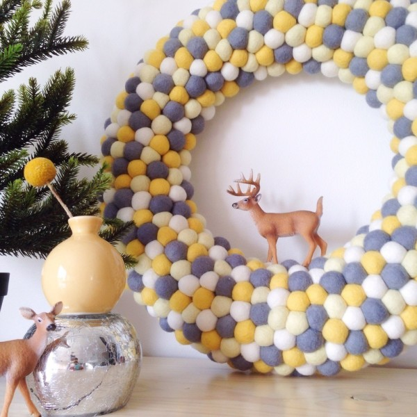 """Extra-large feltball wreath and garland in """"Christmas Gold"""", AU$125, from Down That Paper Lane. Photography courtesy of Little Puddles."""