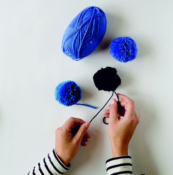 Make your pompoms. From Make & Do by Beci Orpin, via WeeBirdy.com.