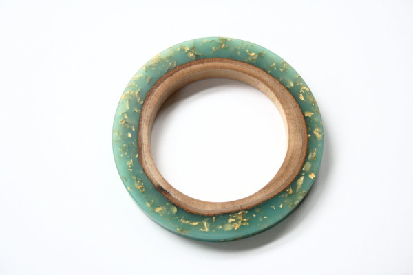 Large bangle handmade from Australian wood and teal blue resin with embedded gold leaf flakes, AU$109, by Bold B, via WeeBirdy.com.