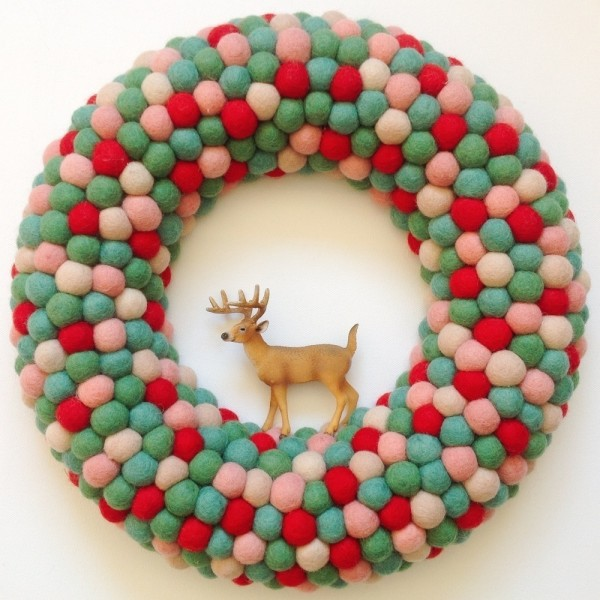 """So sweet: Medium feltball wreath in """"Oh Christmas Tree"""", AU$95, from Down that Little Lane."""