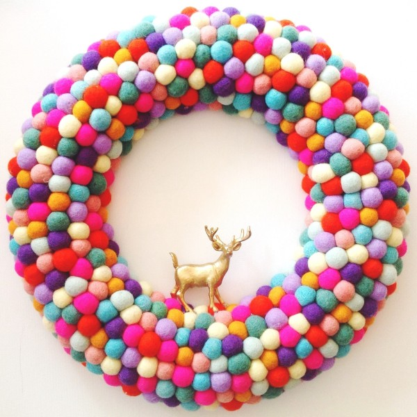 """Colourful Christmas: extra large feltball wreath and garland in """"Rainbow Mix"""", AU$125, from Down That Little Lane."""