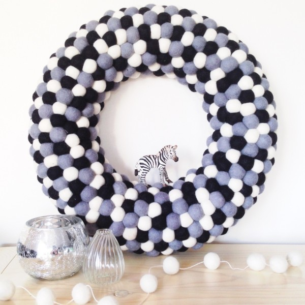 """Large feltball wreath in """"Monochrome"""", $115, from Down That Little Lane. Photography courtesy of Little Puddles."""