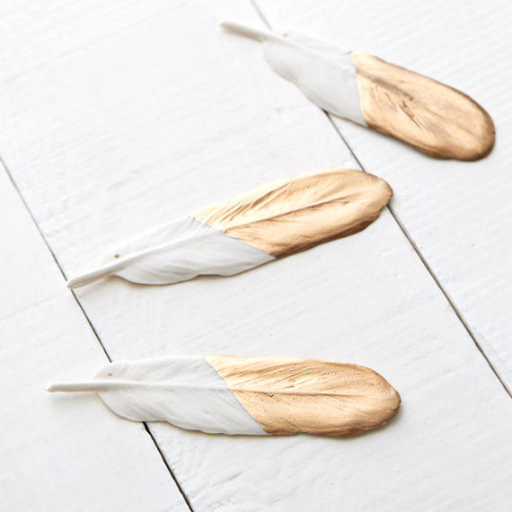 Porcelain and gold leaf feather ornament, $17.32, from Red Raven Studios' Etsy shop.