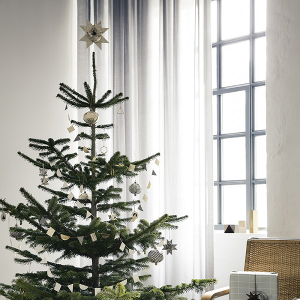 A mix of gold-speckled ornaments adorn Ferm Living's Christmas tree. Photography courtesy of Ferm Living.