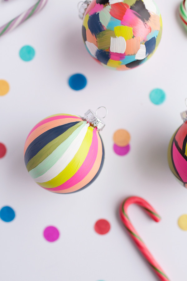 5 Gorgeous New Christmas Crafts to Make: DIY painted ornaments tutorial by Tell Love and Chocolate.