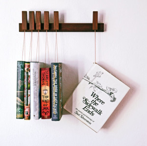 25 Excellent Presents for Book Lovers, via WeeBirdy.com: Custom-made wooden book rack, $129.21 from Agustav's Etsy shop.