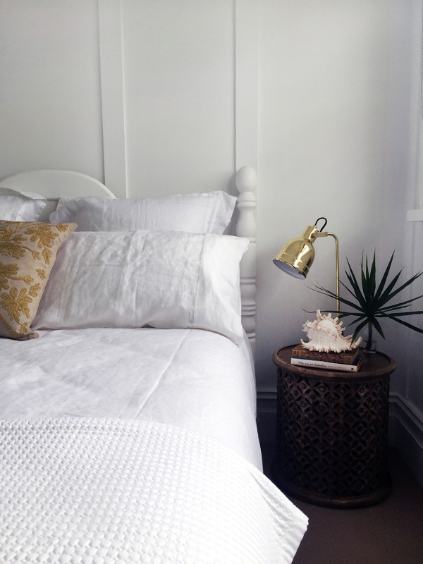 Layers of texture in the master bedroom with bedding by Sheridan. Photo by Rebecca Lowrey Boyd.