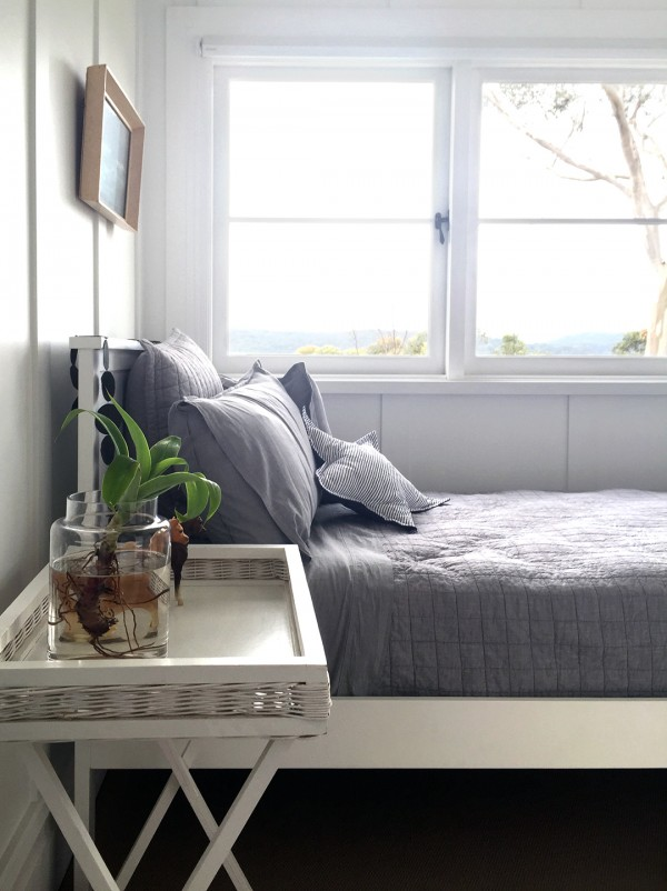 Guest bedroom in beach house. Photo by Rebecca Lowrey Boyd for We Are Scout.