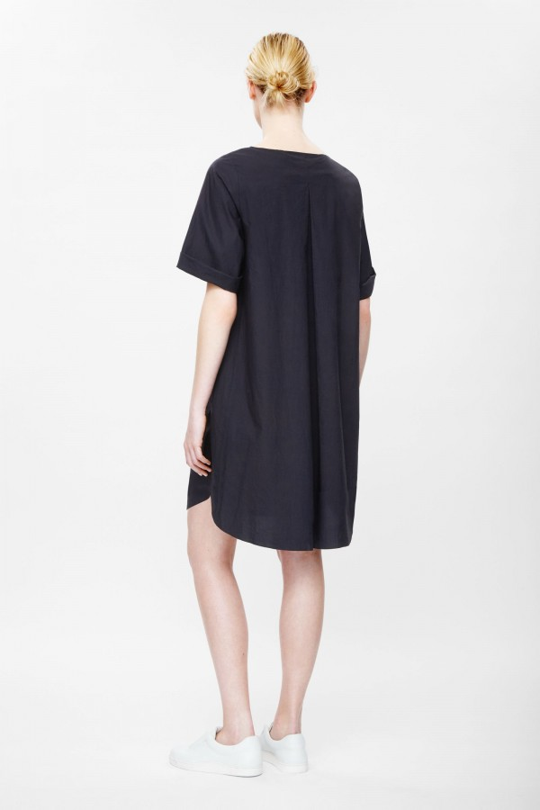 Pleated back dress, available in navy and green, £59, from COS.