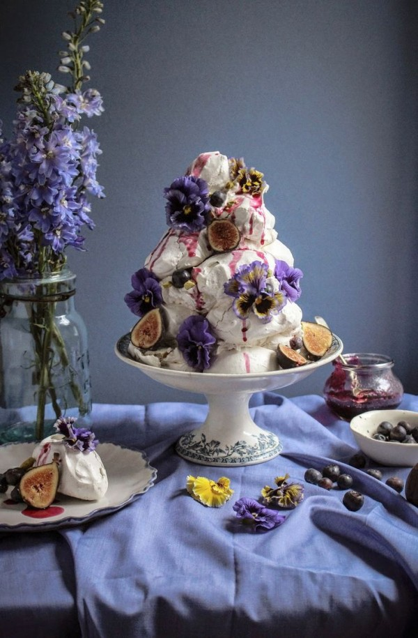 Earl Grey pistachio meringue tower with blueberries and figs and edible flowers by Twigg Studios.