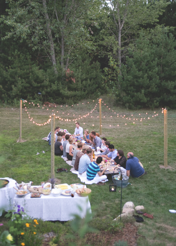 A simple dinner party made magical with globe string lights, via The Fresh Exchange.