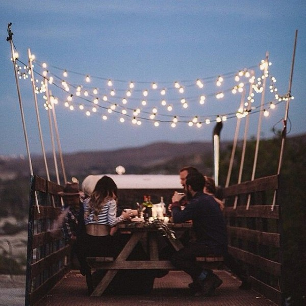 String lights add a touch of magic to this dining table - truck style.