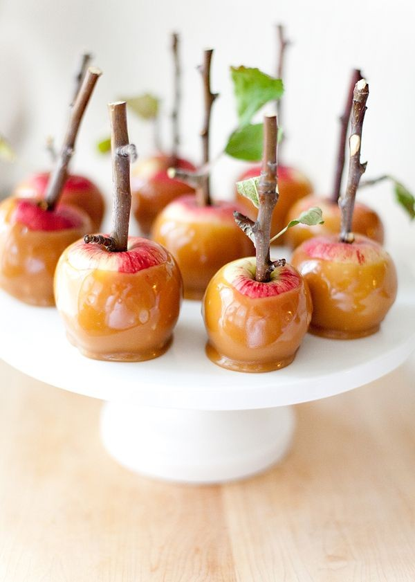 Caramel apples with twig stems by The Broke Ass Bride.