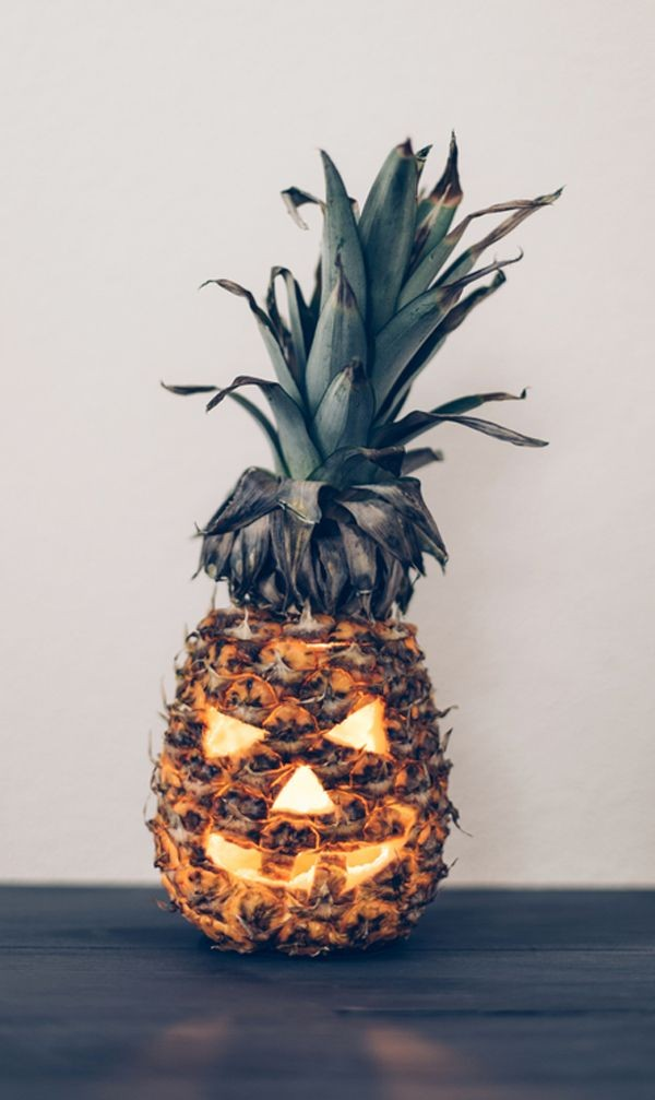Carved pineapple Jack-'o-lantern by A Subtle Revelry.