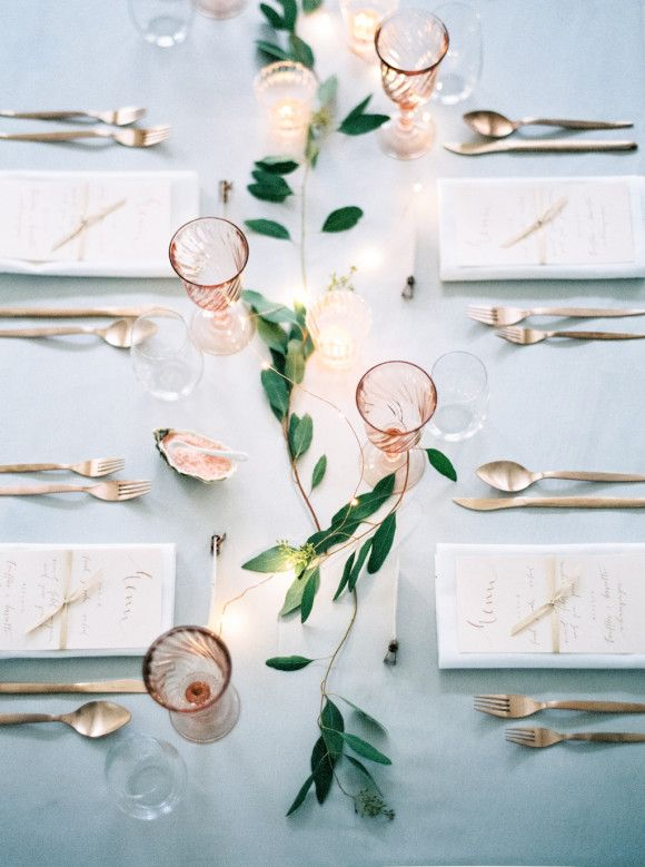 A simple jasmine garland adorns this classic table setting, via Wedding Sparrow.