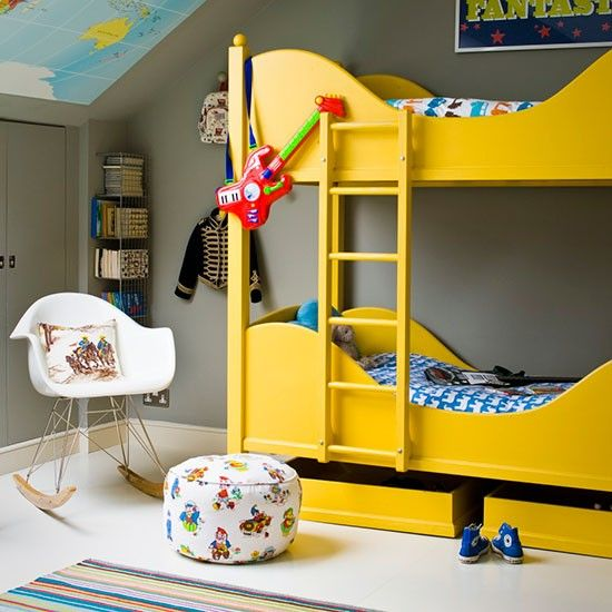 Room for two with a bright yellow bunk bed via House to Home. The children have bed linen with different prints in matching tones.