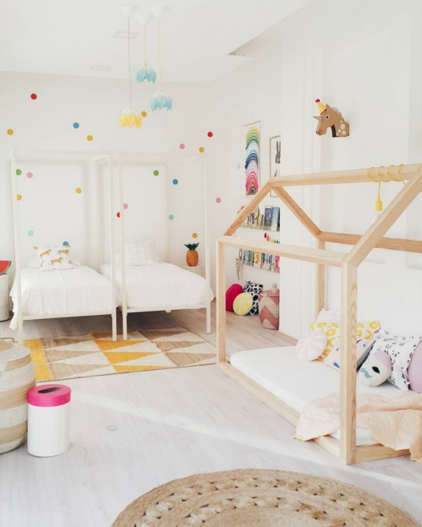 A light and bright room for two, with a bonus timber house day bed/cubby, via Live Loud Girl.