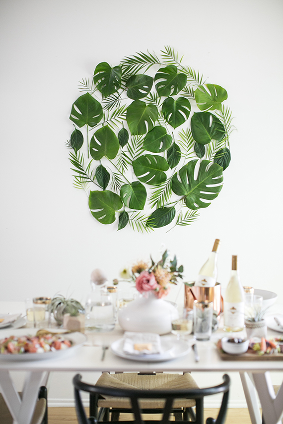 A DIY Leaf backdrop for a dinner party by Almost Makes Perfect.