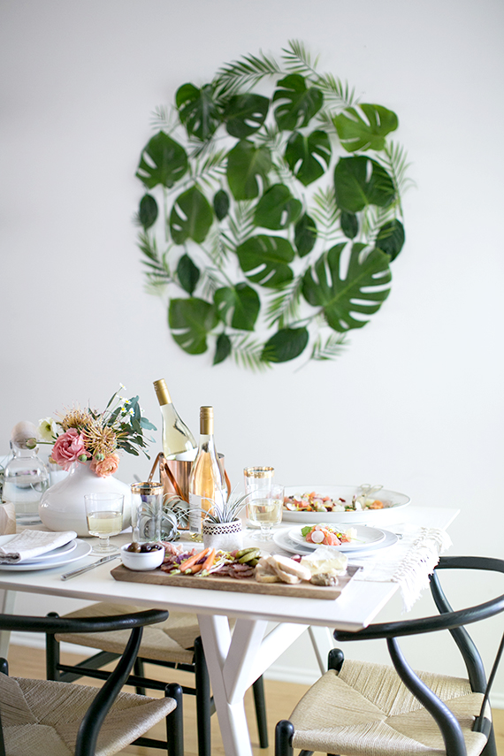 Gorgeous green leaf backdrop set the scene for this table via Almost Makes Perfect.