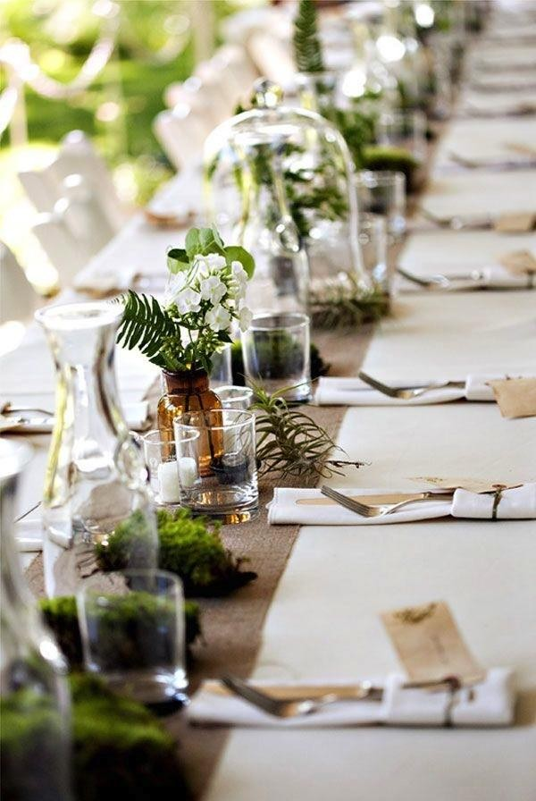 Moss and terrariums bring this table to life. Photo by Erin Grace via 100 Layer Cake