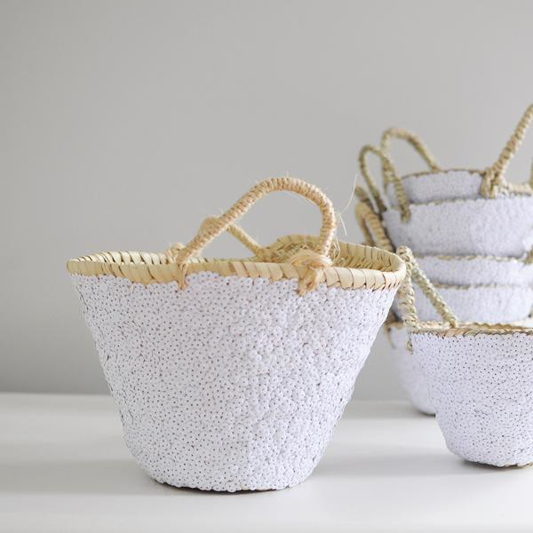 White sequin baskets and planters.