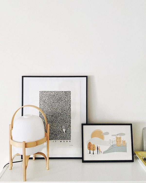 The organic shape of the Cesta lamp softens the geometric lines in this vignette, by Ines Garp.