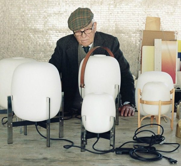 Miguel Milá with his iconic Cesta lamp. Photography courtesy of Santa & Cole.