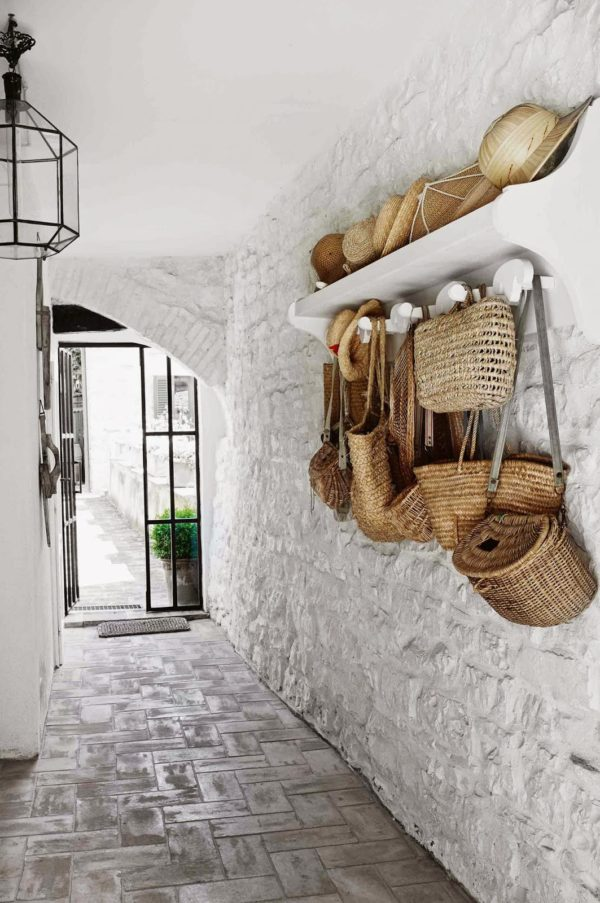 A row of hooks and woven baskets look at home in this rustic Italian cottage. Photo via Berenice Blog.